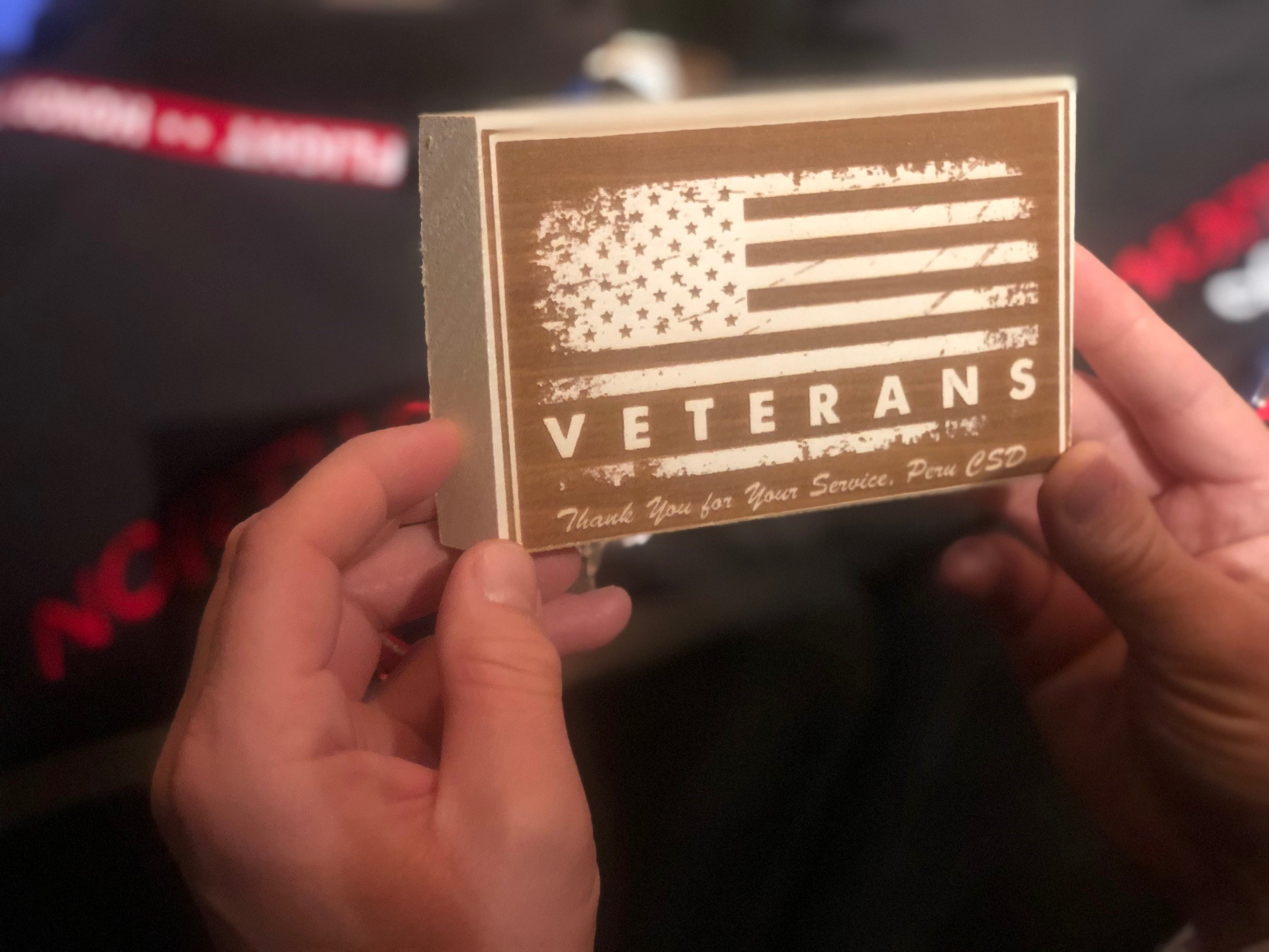 Veteran holding a block honoring all Veterans